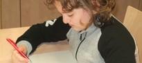Hör-Sprachtraining mit einem Schulkind