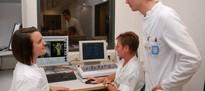 Arzt, Physiker und MTRA planen gemeinsam die Behandlung